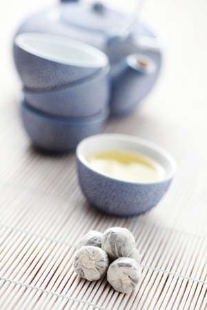 stillife: tea kettle and cup od green tea - tea time