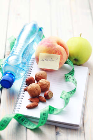 diet diary and fresh fruits - diet and breakfast photo