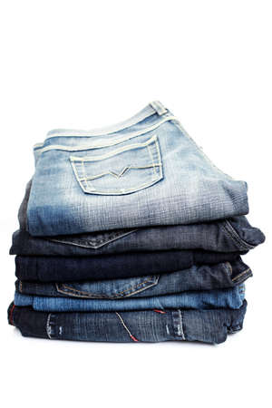 blue  jeans: stack of blue jeans on white background Stock Photo