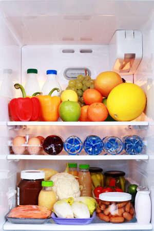 refrigerator full of healthy eating - food and drink photo
