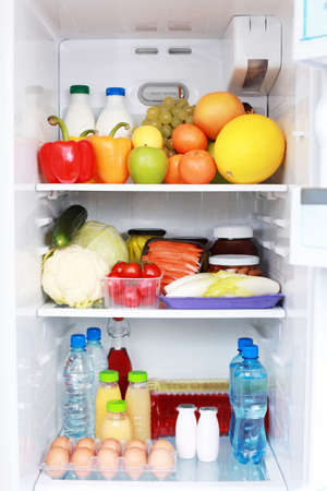 refrigerator with food: refrigerator full of healthy eating - food and drink Stock Photo