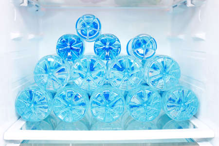 the frozen water: refrigerator full of water - food and drink