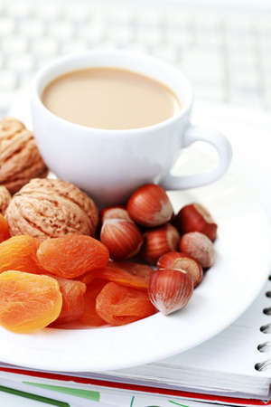 healthy snack in the office - plate of delicacies photo