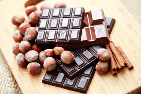 close-ups of chocolate with hazelnuts and cinnamon - sweet food photo