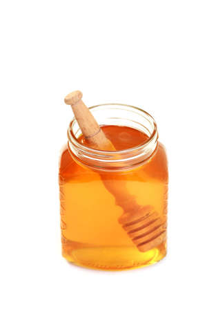 jar of honey on white background - sweet food photo