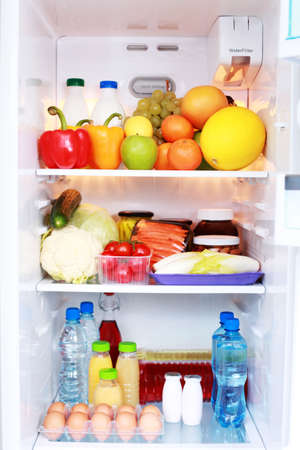 refrigerator: refrigerator full of healthy eating - food and drink Stock Photo