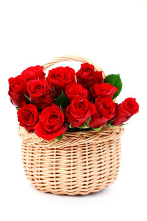 basket full of red roses on white background - flowers and plants photo