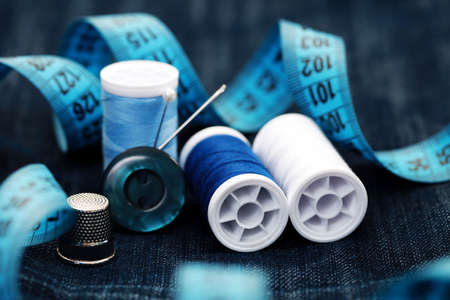 tailor: close-ups of sewing stuff on blue Stock Photo