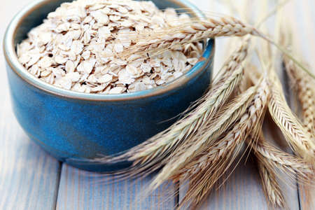 oat plant: blue bowl full of oats - diet and brekafast
