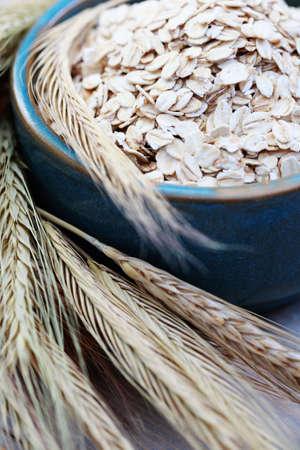 wild oats: blue bowl full of oats - diet and brekafast