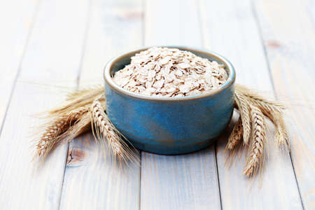 blue bowl full of oats - diet and brekafast Stock Photo - 6166658