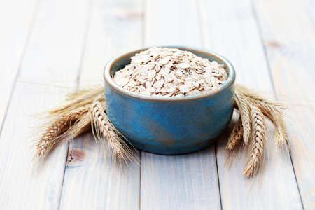 blue bowl full of oats - diet and brekafast