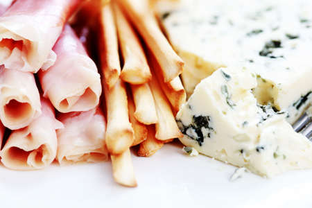 plate of grissini blue cheese and prosciutto - food and drink photo