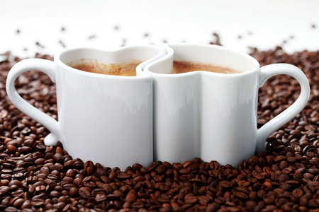 valentine day cup of coffee: 2 cups of coffee shape of heart and coffee beans - coffee time Stock Photo