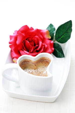 valentine day cup of coffee: cup of coffee shape of heart and red rose - coffee time