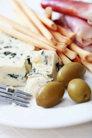 plate of grissini blue cheese and olives - food and drink photo