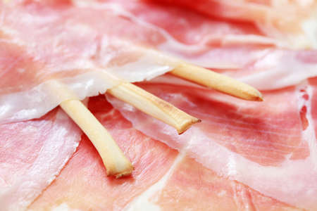 grissini: close-ups of grissini in prosciutto - food and drink