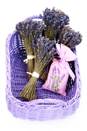 dried flowers: potpourri bag with basket of lavender flowers on white focus on bag