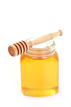 cold remedy: jar of honey on white background - sweet food