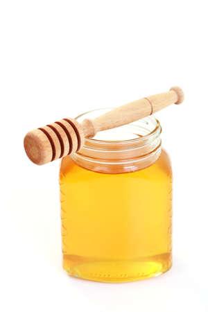 jar of honey on white background - sweet food photo