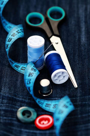 centimetres: close-ups of sewing stuff on blue Stock Photo