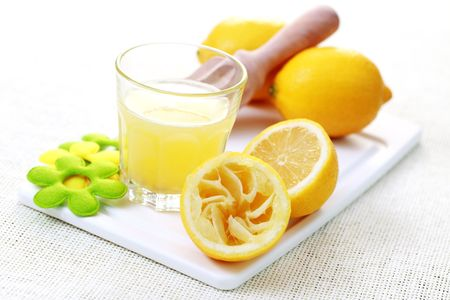 glass of fresh lemon juice with fresh fruits - food and drink Stock Photo - 6621675