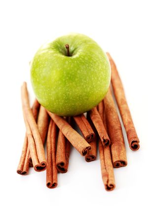 apple and cinnamon sticks on white - fruits and vegetables photo