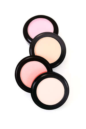 four different color powder compact - beauty treatment photo