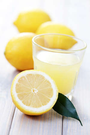glass of fresh lemon juice with fresh fruits - food and drink Stock Photo - 6770414