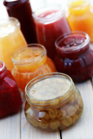 fruity: different jars full of fruity jam - food and drink Stock Photo