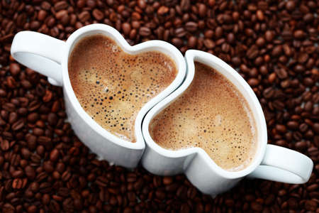 coffee time: 2 cups of coffee shape of heart and coffee beans - coffee time Stock Photo
