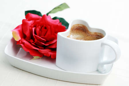 cup of coffee shape of heart and red rose - coffee time photo