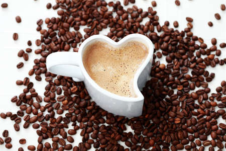 valentine day cup of coffee: cup of coffee shape of heart and coffee beans - coffee time