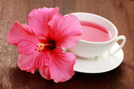 cup of hibiscus tea with beauty flower - tea time photo