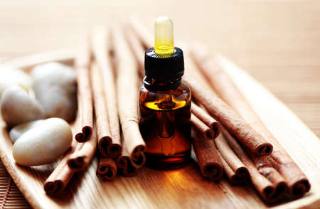 bottle of cinnamon essential oil - beauty treatment photo