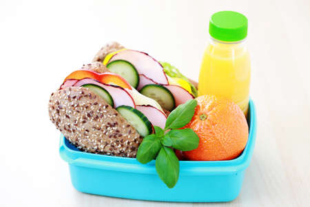 lunchtime: lunch box with delicious sandwich and fruits - food and drink