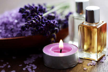 oil massage: bowl of lavender bath salt and massage oil - beauty treatment Stock Photo