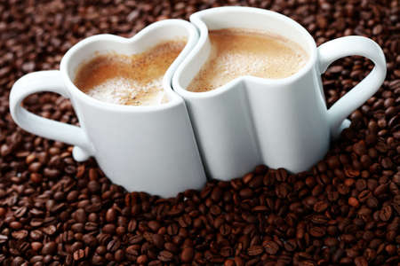 2 cups of coffee shape of heart and coffee beans - coffee time Stock Photo - 7424775