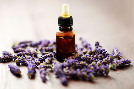 bottle of lavender massage oil with fresh lavender flowers - beauty treatment