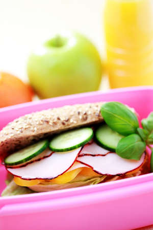 box with delicious sandwich and some fruits - food and drink photo