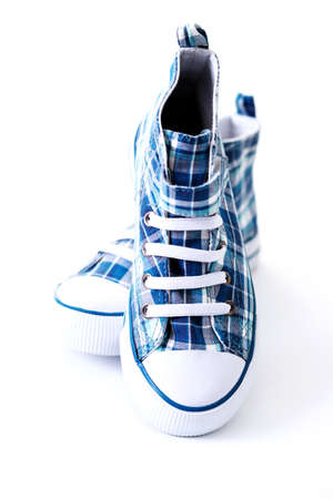 pair of blue and white sneakers on white photo
