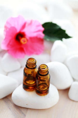 bottle of hibiscus esential oil - beauty treatment photo