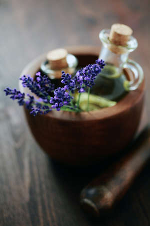 massage oil: lavender massage oil with mortar and pestle - beauty treatment Stock Photo