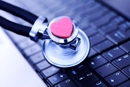 close-ups of laptop and stethoscope as a medical help Stock Photo - 7915893