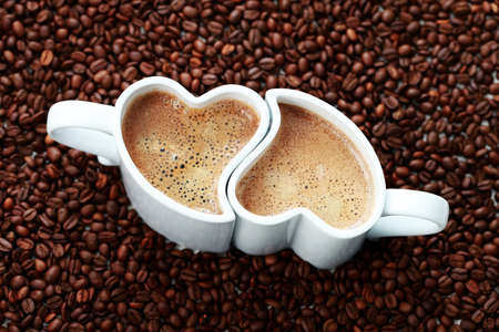 2 cups of coffee shape of heart and coffee beans - coffee time Stock Photo