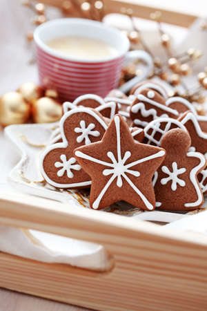 plate full of Christmas gingerbreads and cup of coffee - sweet food photo