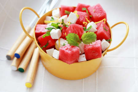 feta cheese: bowl of watermelon and feta salad - food and drink