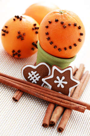 oranges with cloves and gingerbreads with spices - Christmas time photo