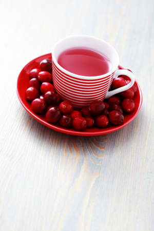 cup of cranberry tea with fresh cranberry fruits - tea time Stock Photo - 8361315