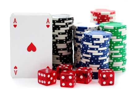 poker chips with cards  and dices on white background photo